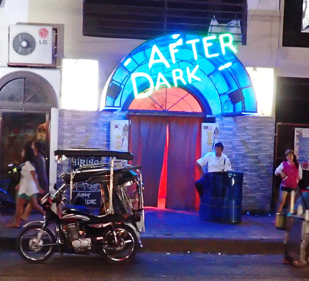 Outside of After Dark Bar with a Trike (probably the guys from Trikepatrol.com) and the neon sign