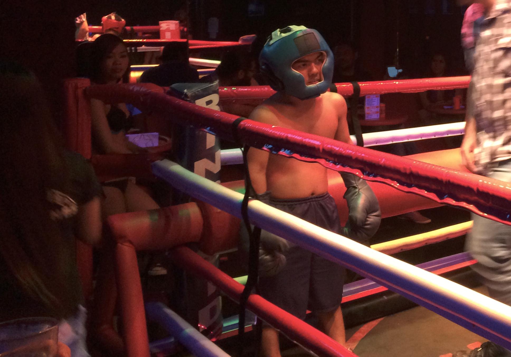 A midget boxer prepares for the next round.