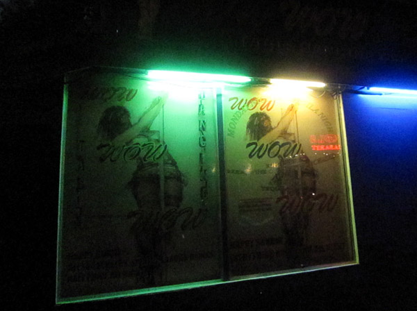 The poster advertising Wow Wow Wow bar in Makati